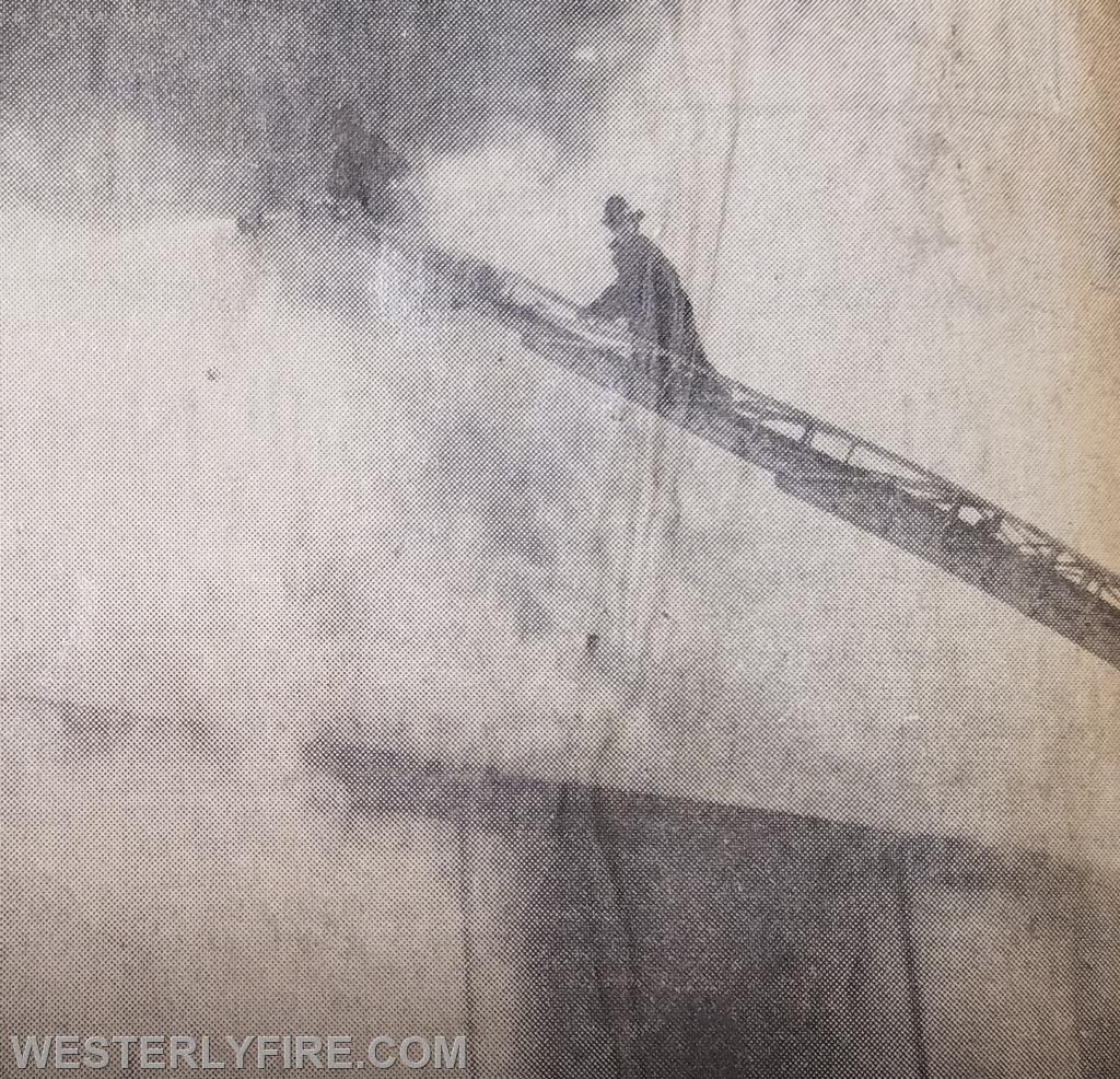 Members of the Alert Hook & Ladder Co. 1 operate their ladder pipe into the center of the warehouse. Box 3152, 2/18/1969