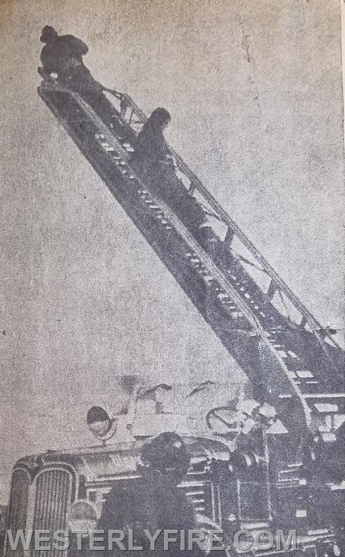 Members of the Alert Hook & Ladder Co. 1 set up  their ladder pipe at Collings Warehouse fire. Box 3152, 2/18/1969