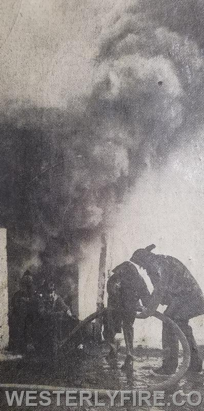 Members continue to take a beating operating a 2 1/2 handline at Collings Warehouse fire. Box 3152, 2/18/1969