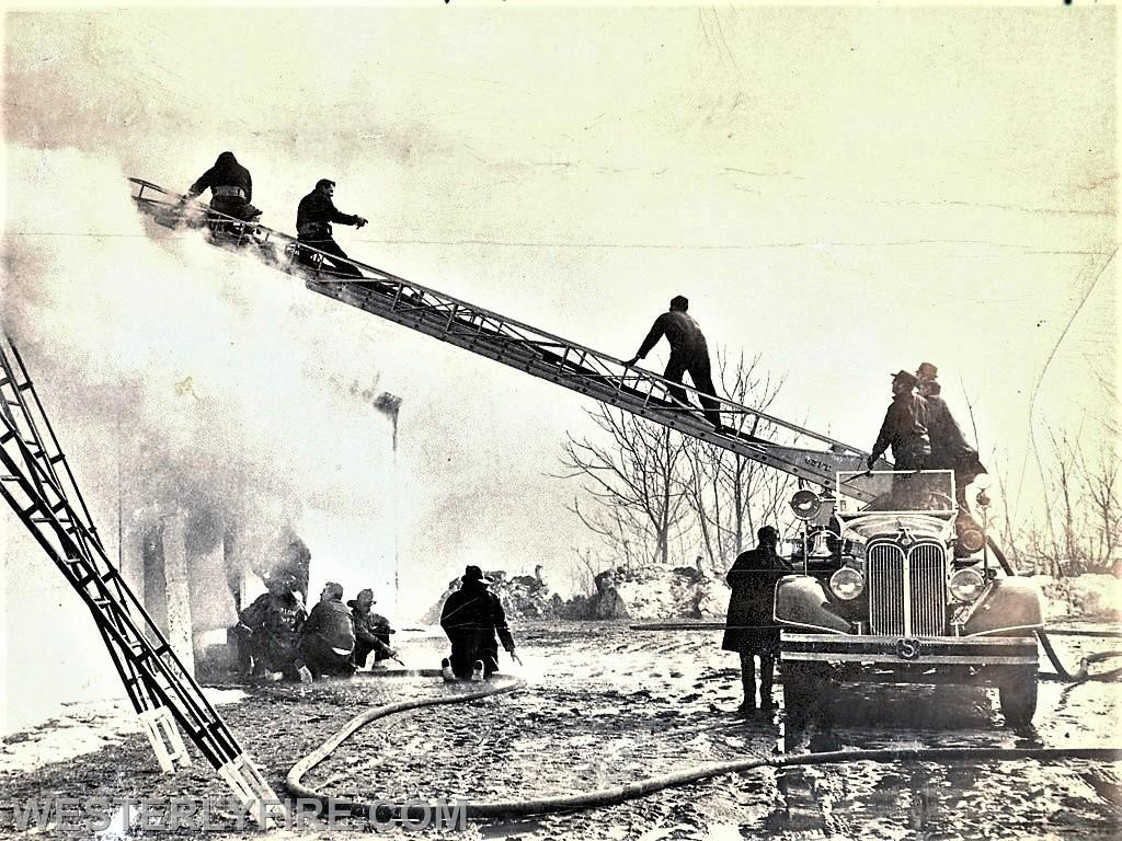 Members of the Cyclone Engine Co. 2 operate below while members of Alert Hook & Ladder Co 1 operate above. Box 3152 2/18/1969