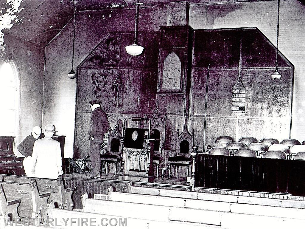 Box 4115-4-23-1964-Resident Fireman Ed Greene, RI State Fire Marshal and Chief Columbus Pasetti inspect the damage to the altar at the Pleasant St. Baptist Church.