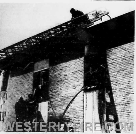 May 15, 1974 Boxes 3131 and 612-Westerly firefighters work via ground ladders and the aerial ladder to complete extinguishment of a smoky blaze at the Immaculate Conception Church at 111 High St.