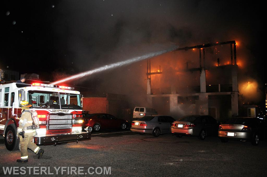 Box 322 June 23, 2014. Lombardo Building. Engine 4's deck gun goes to work on the rear deck.