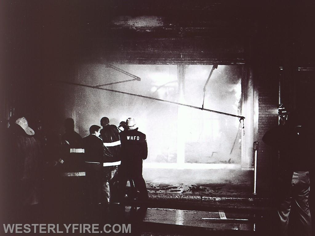 Box 3111 June 6, 1964. Westerly Furniture in the Lombardo Building. Westerly, Pawcatuck and Watch Hill firemen advance their lines.