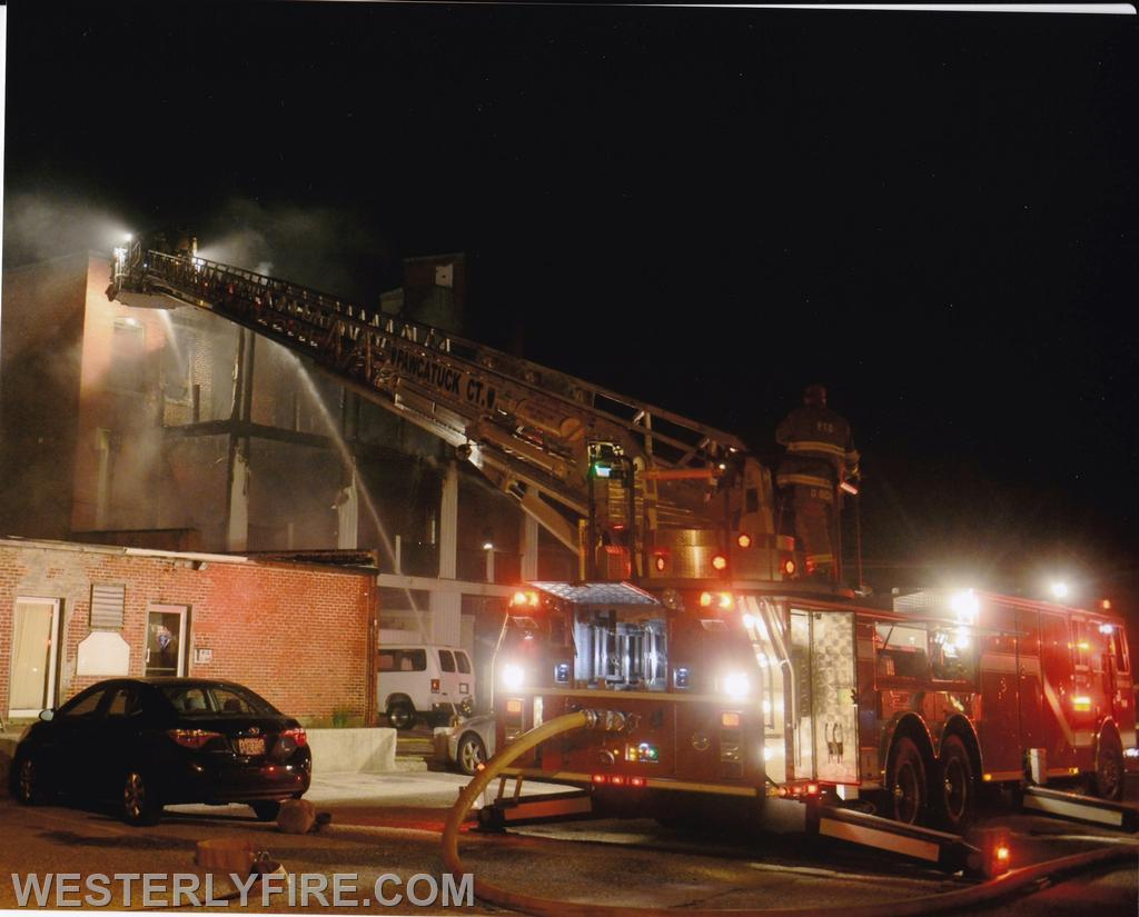 Box 322 June 23, 2014. Lombardo Building. Pawcatuck's ladder truck works the rear of the building.