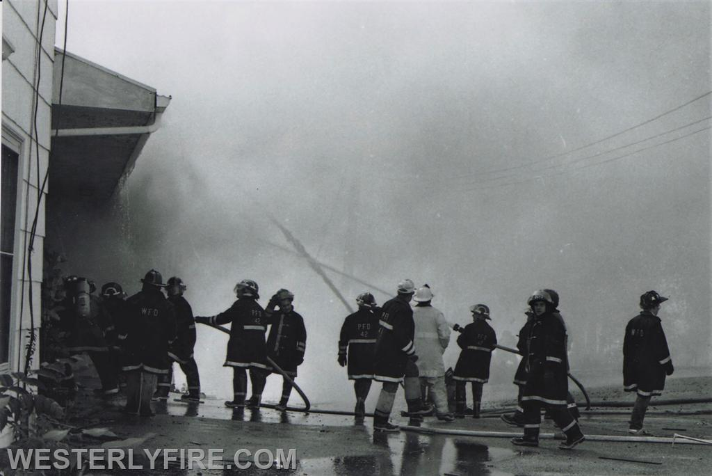 Box 1123- 8-15-1987-Pawcatuck firefighters attack the fire at the Hanley-Williams Lumber Yard from the north side of the building.
