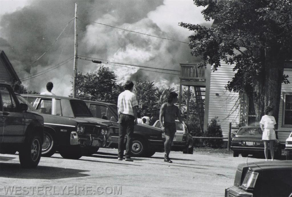 Box 1123- 8-15-1987- The explosion of flames as spectators view the Hanley-Williams fire from the area near Buckler-Johnston funeral parlor.