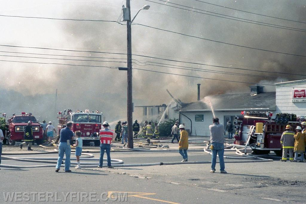 Box 1123- 8-15-1987- A view from the McQuade's parking lot showing the Hanley-Williams fire being brought under control.